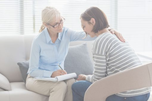 Therapist comforting patient while practicing professionalism and boundaries