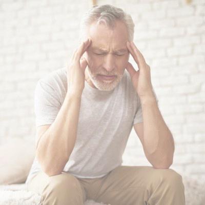 man experiencing stroke-like symptoms such as headache